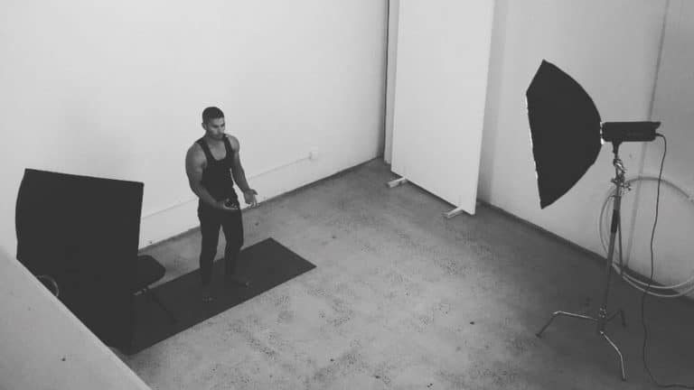 Darius teaching and filming about fitness and hand stand at 11past11studio